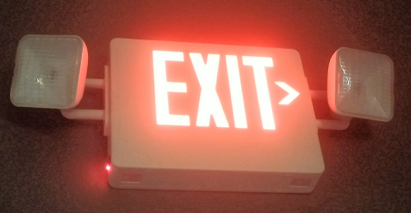 Joplin dentist office exit sign with mergency lights.