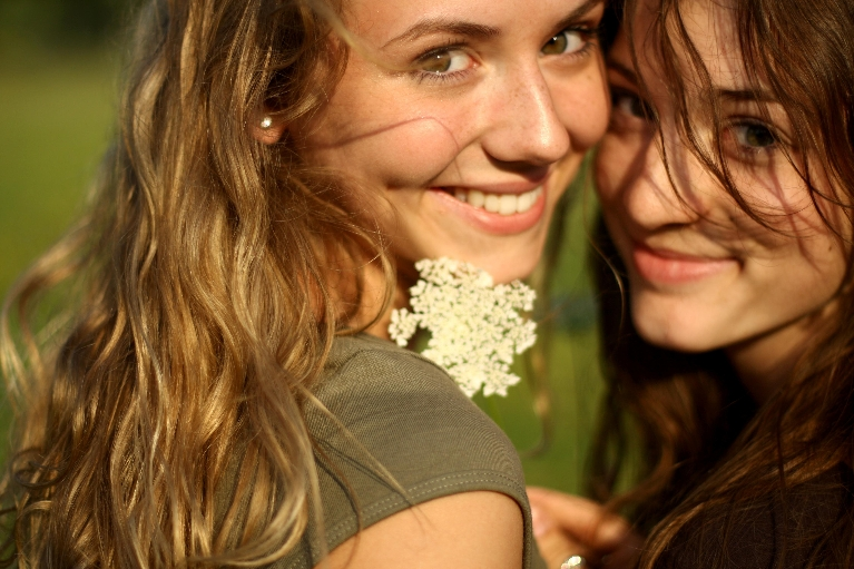 Picture of two girls with straight teeth and white teeth