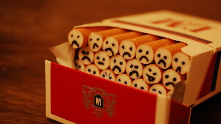 Pack of Cigs with frowny faces on filter